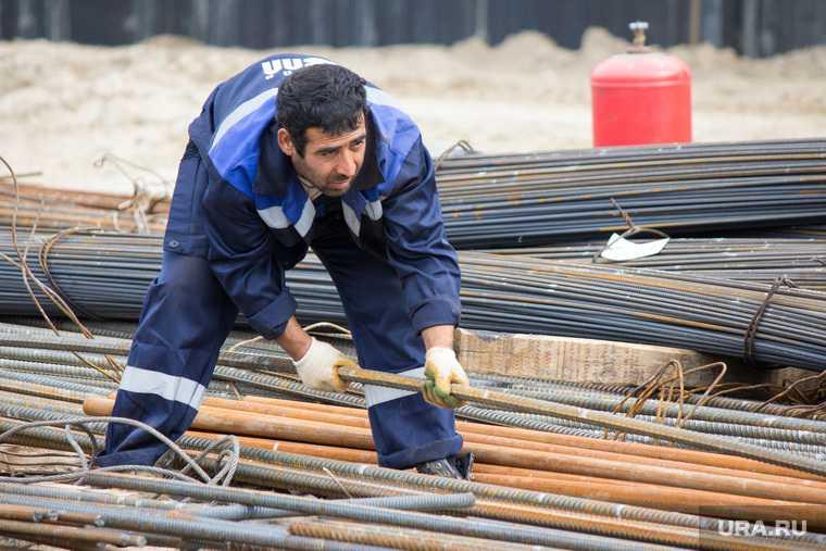 мигранты стройка работа